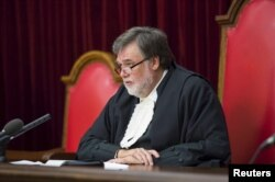 Judge Eric Leach delivers his judgement in the Oscar Pistorius case in the Supreme Court of Appeal in Bloemfontein, Dec. 3, 2015.