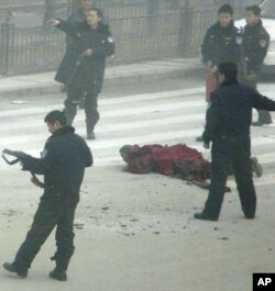 Armed police surround Tapey after he set himself ablaze in Aba, in China's southwest Sichuan province Friday, Feb. 27, 2009.