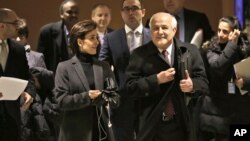 Palestinian Ambassador to the United Nations Riyad Mansour (L) and Jordanian Ambassador Dina Kawar leave a meeting of Arab states at U.N. headquarters, Dec. 29, 2014.