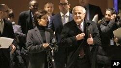Palestinian Ambassador to the United Nations Riyad Mansour (L) and Jordanian Ambassador Dina Kawar leave a meeting of Arab states at U.N. headquarters, Dec. 29, 2014.