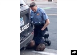 FILE - In this Monday, May 25, 2020, file frame from video provided by Darnella Frazier, a Minneapolis officer kneels on the neck of George Floyd, a handcuffed man who was pleading that he could not breathe. The death of Floyd has renewed scrutiny of immo