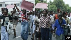FILE: Members of the Women of Zimbabwe Arise (WOZA) group, march on the streets of Harare, Thursday, Nov. 17, 2005. (AP Photo)