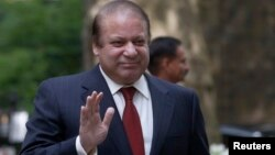 FILE - Pakistan's Prime Minister Nawaz Sharif waves as he arrives in Downing Street in London, April 2014.