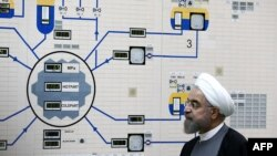 FILE - A handout picture released by the official website of the Iranian President Hassan Rouhani shows him visiting the control room of the Bushehr nuclear power plant in the Gulf port city of Bushehr, Jan. 13, 2015.