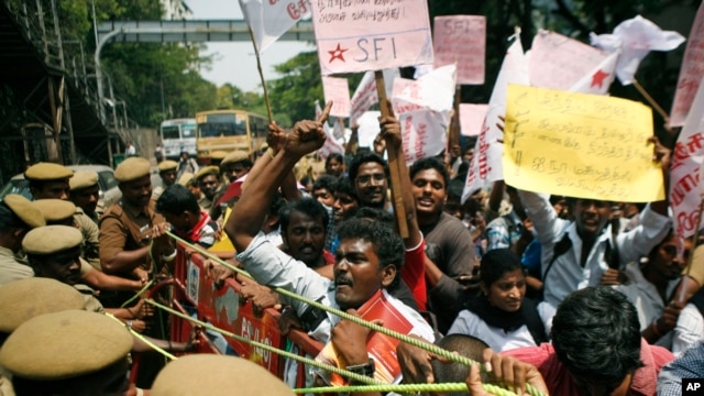 India Tamil activists try to push past a barricade during a protest against alleged wartime abuses by Sri Lanka in Chennai, India.