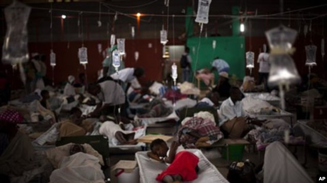 People suffering cholera symptoms are treated in a sports center converted into a cholera treatment center in Cap Haitien, Haiti, 23 Nov 2010