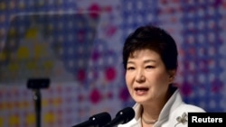 FILE - South Korean President Park Geun-hye delivers a speech in Seoul, March 1, 2016. She accepted the resignations of her chief of staff and the senior secretaries for policy coordination, political affairs, civil affairs and public relations.