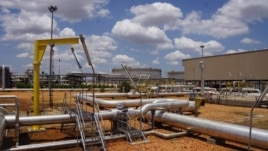 Pipelines criss-cross at the Paloch oil field in South Sudan on Sunday, May 5, 2013, when production resumed at the facility after a 16-month break.