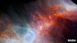 This Infrared observation of the Orion nebula highlights fledgling stars hidden in gas and clouds. It was taken by NASA's Spitzer Space Telescope and the European Space Agency's Herschel mission. (Photo: (NASA/ESA/JPL-Caltech/IRAM )