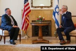 U.S. Secretary of State Mike Pompeo meets with Israeli Speaker of the Knesset Benjamin Gantz, in Israel, May 13, 2020. (Credit: State Department Photo by Ron Przysucha)