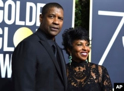 Denzel Washington, left, and Pauletta Washington arrive at the 75th annual Golden Globe Awards at the Beverly Hilton Hotel on Sunday, Jan. 7, 2018, in Beverly Hills, Calif.