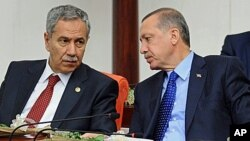 FILE - Turkey's Prime Minister Recep Tayyip Erdogan (r) and his deputy Bulent Arinc.