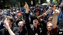 FILE - Demonstrators shout slogans directed at city hall during a rally for free speech Thursday, April 27, 2017, in Berkeley, Calif. (AP Photo/Marcio Jose Sanchez)