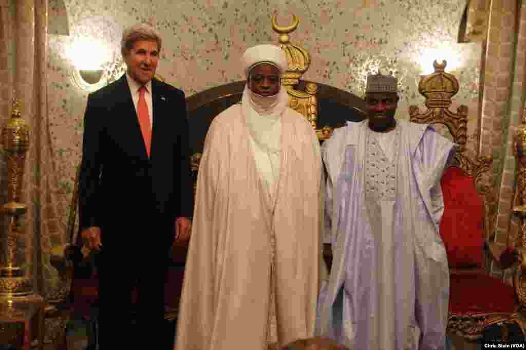 From left, U.S. Secretary of State John Kerry stands with Sultan of Sokoto Sa'adu Abubakar and Governor of Sokoto State Aminu Tambuwal in Sokoto, Nigeria, Aug. 23, 2016.
