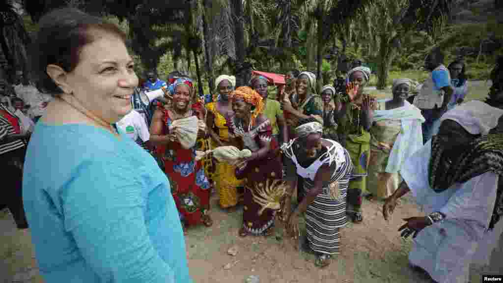 United Nations Children's Fund (UNICEF) Ivory Coast Representative Adele Khudr receives a welcome ceremony from the locals as she arrives for a Ebola awareness drive in Gueupleu, Man, in western Ivory Coast, Nov. 3, 2014.