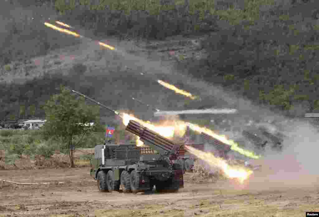 Cambodian soldiers test fire the BM-21, a multiple rocket launcher, during training at a military base in Kampong Speu province.