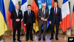 French Foreign Minister Laurent Fabius, Ukrainian Foreign Minister Pavlo Klimkin, German Foreign Minister Frank-Walter Steinmeier and Russian Foreign Minister Sergey Lavrov, from left, pose for a group photo at Villa Borsig, in Berlin, April 13, 2015