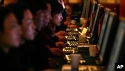FILE - Chinese are seen working on computer work stations. Called 'bo ke' in Chinese, blogs are hugely popular, especially among the young, despite strict rules on content enforced by the government.