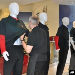 Hudson's Bay company store employee Brian McLelland rearranges a black t-shirt on a display figure