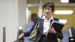 11月28日参议员苏珊•柯林斯去参加参议院国土安全与政府事务委员会主要成员与苏珊•赖斯的会议