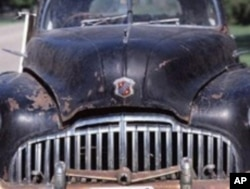 A wonderful demolition derby car candidate. Just knock out the windshield, take the gas tank inside, and off you go.
