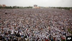 Tens of thousands of protestors from Gujarat's Patel community participate in a rally in Ahmadabad, India, Tuesday, Aug. 25, 2015. The members of the community from this western Indian state are demanding affirmative action for better access to education
