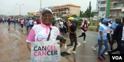 Cancer survivor Zainab Mohammad takes part in a cancer awareness walk in Abuja, Nigeria, Oct. 26, 2019. (Timothy Obiezu/VOA)