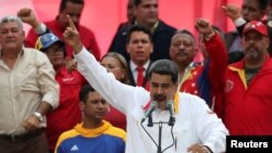 FILE - Venezuela's President Nicolas Maduro talks during a rally in support of the government in Caracas, Venezuela, May 20, 2019.
