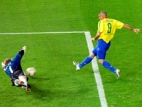 Brazil's Ronaldo beats Germany's goalie Oliver Kahn to score during the second half of the 2002 World Cup final.