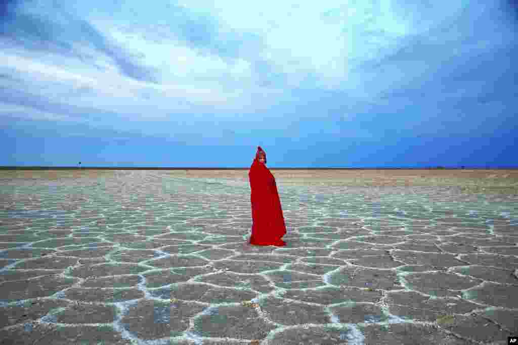 A woman visits Khour salt lake in the Mesr desert, about 305 miles (500 kilometers) southeast of the capital Tehran, Iran.