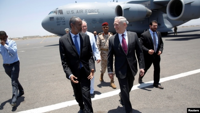 U.S. Defense Secretary James Mattis is greeted by Djibouti's Minister of Defense Ali Hasan Bahdon as he arrives at Djibouti-Ambouli International Airport in Ambouli, Djibouti, April 23, 2017.