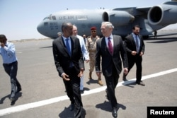 FILE - U.S. Defense Secretary James Mattis is greeted by Djibouti's minister of defense, Ali Hasan Bahdon, as he arrives at Djibouti-Ambouli International Airport in Ambouli, Djibouti, April 23, 2017.