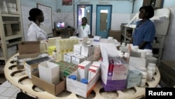 Nurses work in the pharmacy at the general hospital in Man, western Ivory Coast, July 4, 2013.