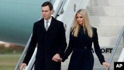 FILE - Ivanka Trump, right, departs Air Force One with Jared Kushner.