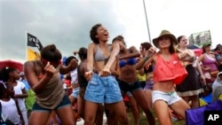 Audience members dance at the New Orleans Jazz and Heritage Festival last year
