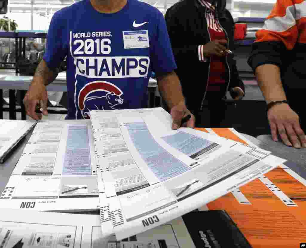 Antonio Martinez, a polling volunteer, prepares ballots at the Su Nueva Lavenderia on Nov. 8, 2016, in Chicago.