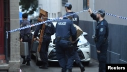 Police raid a property in the Sydney suburb of Surry Hills, Australia, July 31, 2017, in the wake of a plot again Australia's aviation sector.