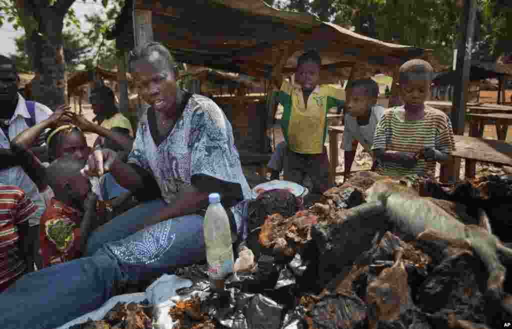 A bushmeat seller in the market in the Bimbo neighborhood of the capital Bangui, Central African Republic, January 1, 2013.