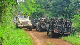 Patrouille mixte ONU-FARDC près de la zone d'une attaque aux ADF à environ 30 km de Beni, en République démocratique du Congo, le 23 juillet 2021.