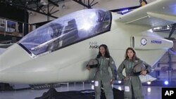 The Advanced High Performance Reconnaissance Light Aircraft (AHRLAC) plane is officially unveiled by South African defense and aerospace giant Paramount Group at a ceremony in Pretoria, South Africa, September 27, 2011.