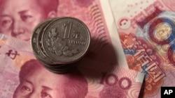 Mata uang China, Yuan, mengalami devaluasi untuk hari kedua berturut-turut (foto: dok).