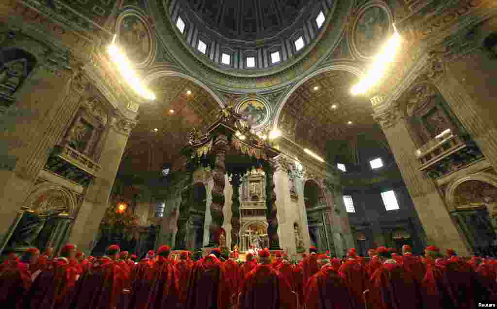 Cardinals attend a Mass in St. Peter's Basilica at the Vatican, March 12, 2013.
