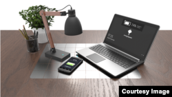 "French startup company EnergySquare showed off what it called a ""universal wireless charger"" for laptop computers. (EnergySquare)"