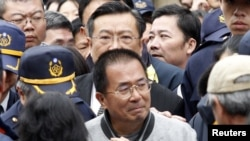 Taiwan's jailed former President Chen Shui-bian leaves a funeral house after paying his respects to his late mother-in-law in Tainan, southern Taiwan, January 6, 2012.