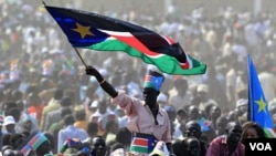 Warga Sudan Selatan merayakan upacara kemerdekaan pada tanggal 9 Juli di ibukota Juba. Sudan Selatan akan menjadi negara anggota PBB ke-193 bila disetujui Majelis Umum PBB.