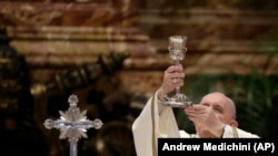 FILE - in this , Thursday, April 1, 2021 file photo, Pope Francis celebrates a Chrism Mass inside St. Peter's Basilica, at the Vatican.