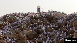 FILE - Muslim pilgrims gather on Mount Mercy on the plains of Arafat during the annual haj pilgrimage, outside the holy city of Mecca, Saudi Arabia, Sept. 11, 2016.