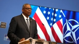 U.S. Defense Secretary Lloyd Austin speaks during a media conference after a meeting of NATO defense ministers at NATO headquarters in Brussels, Oct. 22, 2021.