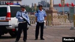 Cảnh sát Trung Quốc canh gác tại Quảng trường Thiên An Môn, ngày 4/6/2014.