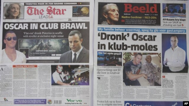 Two Johannesburg newspapers report on Oscar Pistorius, right, recently visited a nightclub with a cousin and was allegedly accosted by a man, Jared Mortimer, left and center, who aggressively questioned him about his murder trial, July 15, 2014.